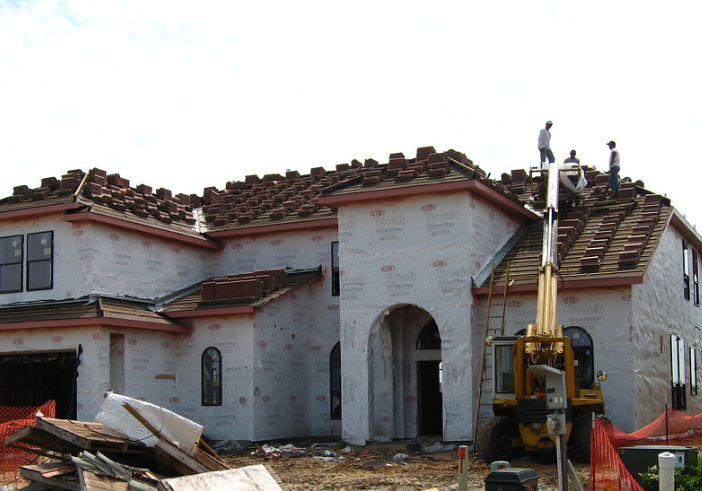 The photo shows the finished roofing work in Chino Hill.