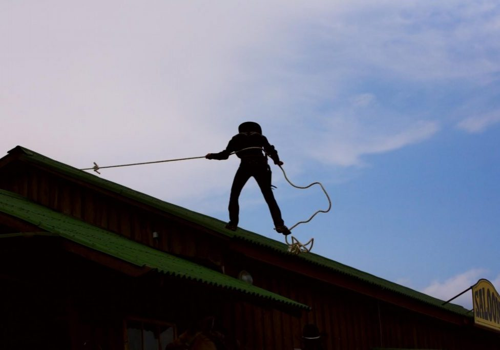 this image shows a roofer at work for commercial roofing chino hills